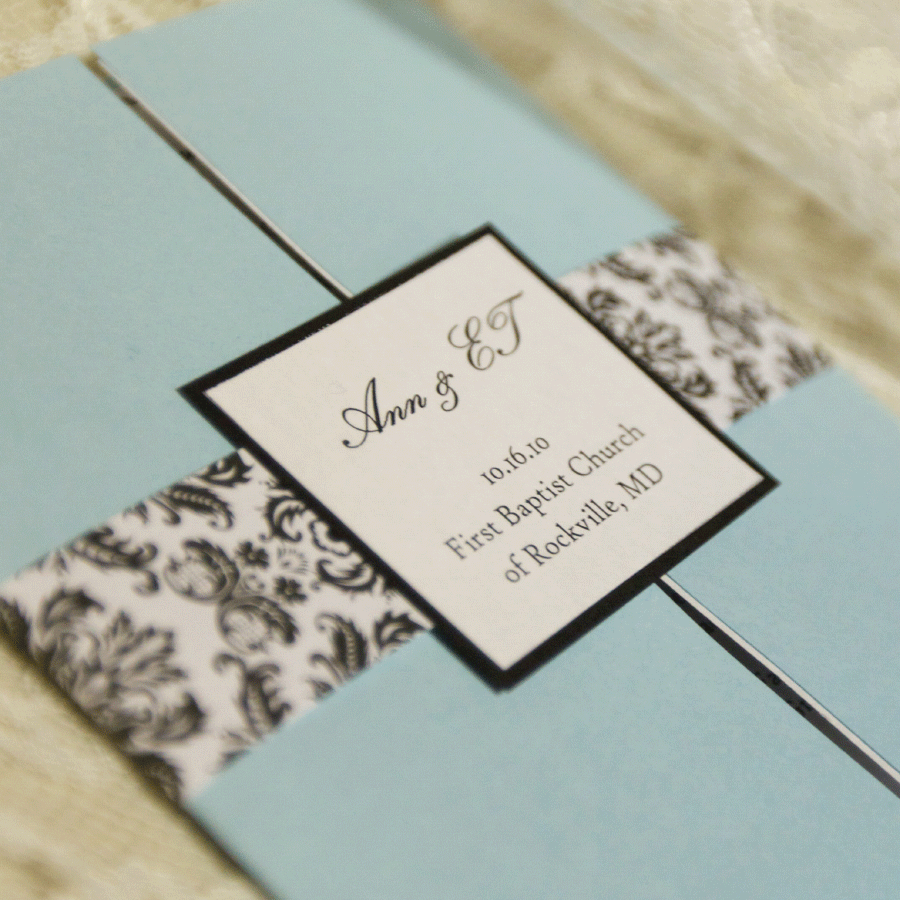 blue, black, and white wedding program